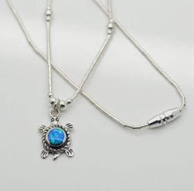 sterling silver necklace  Condition: Brand new Material: .925 Sterling Silver Size of Turtle: 16mm long gemstone size: 5mm round Finishes: Highly Polished finish  This is an Handmade high quality sterling silver necklace. Inlaid blue fire opal with lots of shimmering fire in the opals stunning piece! Stamped 925 Exclusively here directly from it's Designer Artist ! Check our other listings for matching earrings! beautiful gift box included